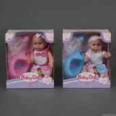 """Многофункциональная кукла""""Baby born""""закрывает/открывает глазки,пьет,писяет.Бутылочка,соска и горшок."""