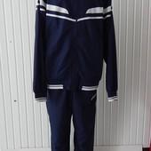 Спортивный синий мужской костюм asics с полосами