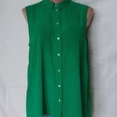 Лёгенькая фирменная блузочка с удлиненной спинкой в отличном состоянии! Грудь-110 см