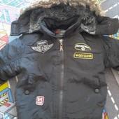 Теплая куртка с меховой подкладкой