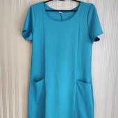 Трикотажное платье с карманами.