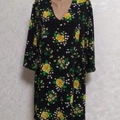 Красивое фирменное платье р.50/52. В состоянии новой вещи.
