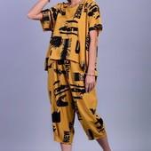 Летний костюм, размер универсальный от 46 до 54. Цвет:красный,желтый,черный.О покупке не пожалеете!